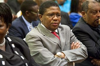 Fikile_Mbalula_sitting_in_chair