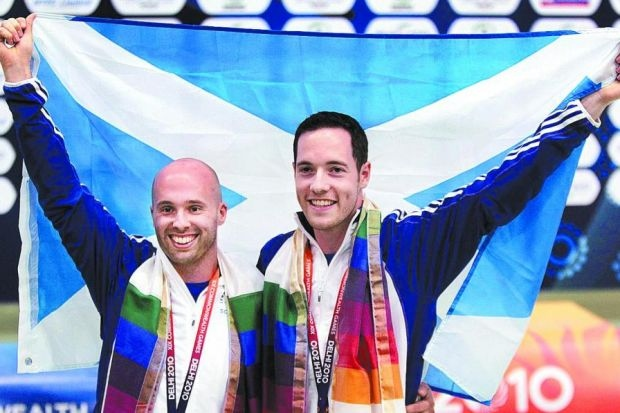 Neil_Sirton_on_right_with_Scottish_flag