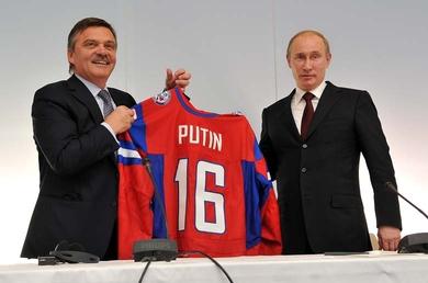 Rene_Fasel_awards_jersey_to_Vladimir_Putin_Bratislava_May_13_2011