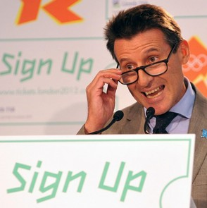 Sebastian_Coe_playing_with_glasses_behind_sign-up_sign_in_Belfast_March_2011