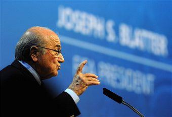 Sepp_Blatter_in_front_of_name_FIFA_Congress_Zurich_June_1_2011