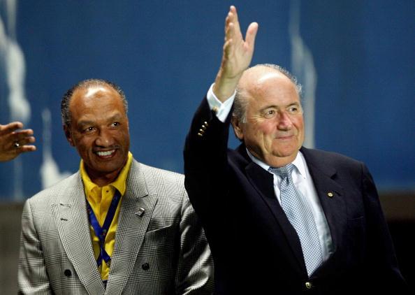 Sepp_Blatter_waving_with_Mohamed_Bin_Hammam