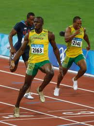 Usain_Bolt_crosses_line_in_100m_at_Beijing_2008